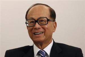 Hong Kong tycoon Li Ka-shing smiles during a news conference in Hong Kong